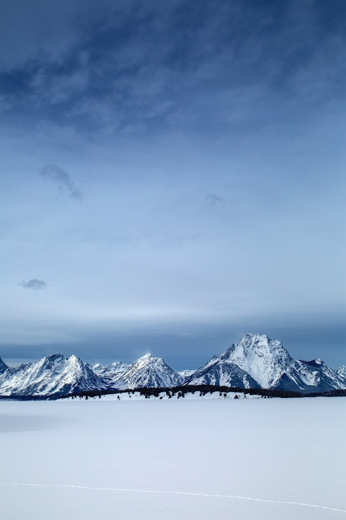 Snow covered Tetons form a frozen Jackson Lake in Grand Teton National Park, WY