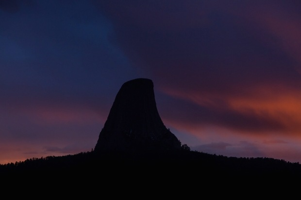 dramatic sunset over Devils tower national monument, WY