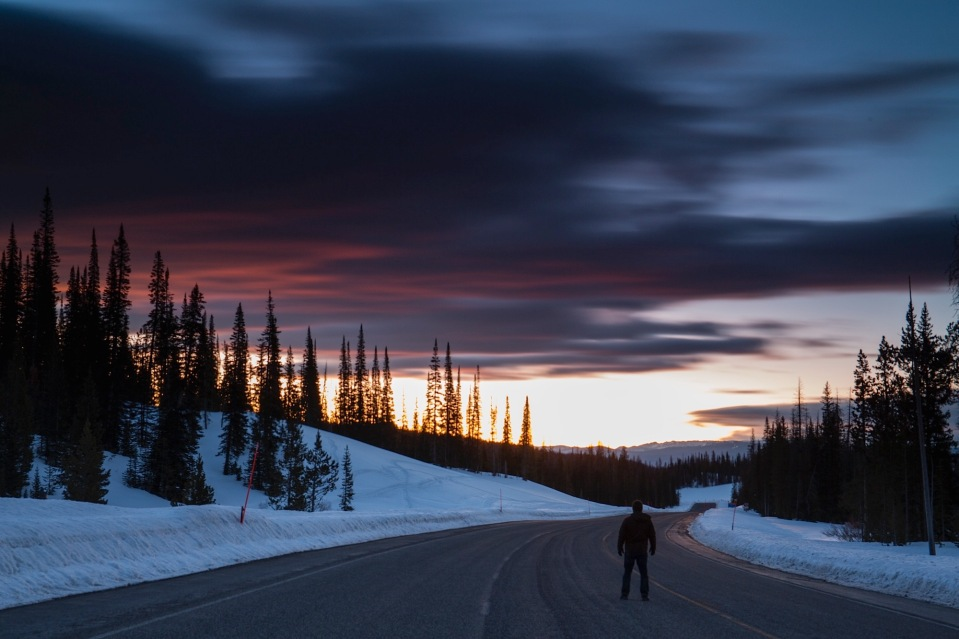 A man watches sunrise on Togwotee pass