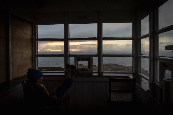 Ellen Slaton gazes out at the view of the Sunset, North Sea, and Isle of Harris
