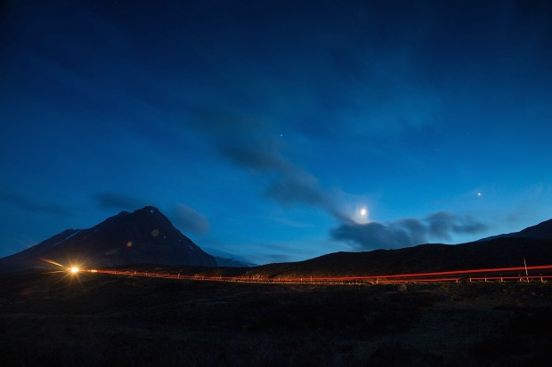 Moon and stars as cars passing on A82 near the River Etive
