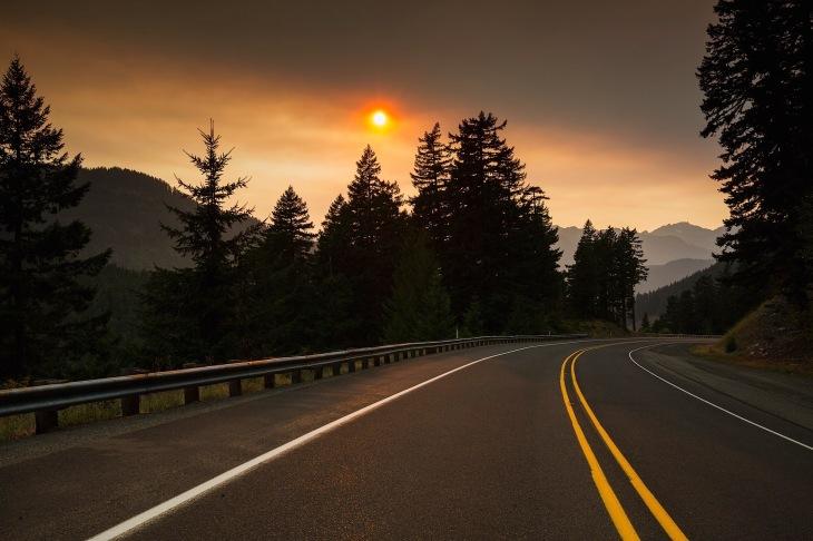 sunset over mount rainier with wildfire smoke