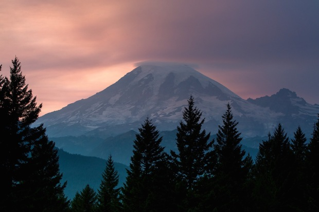 sunset over mount rainier with wildfire smoke