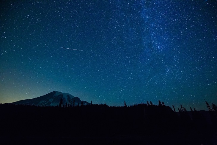 stars and perseids meteor shower over reflection lakes and mount rainier