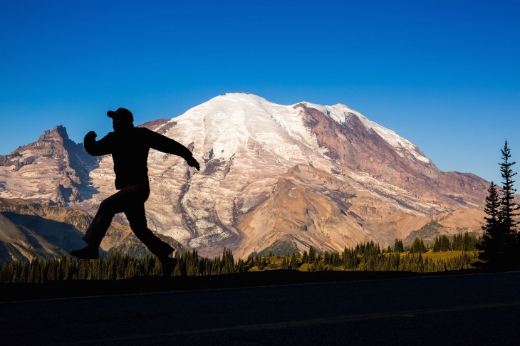 silhouette of a man in front of Mt. Rainier
