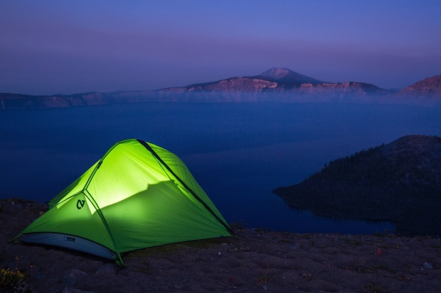Lit tent on the rim at Crater Lake