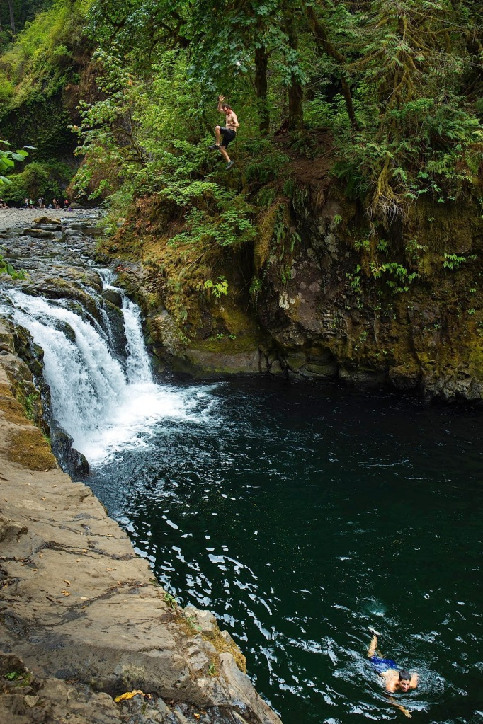 Cliff jumping at Punchbowl Falls