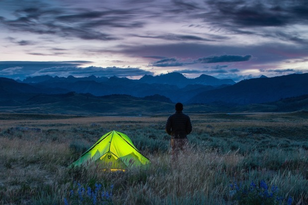 Sunrise over the Winds near Soda Lake, lit Nemo Tent, man camping