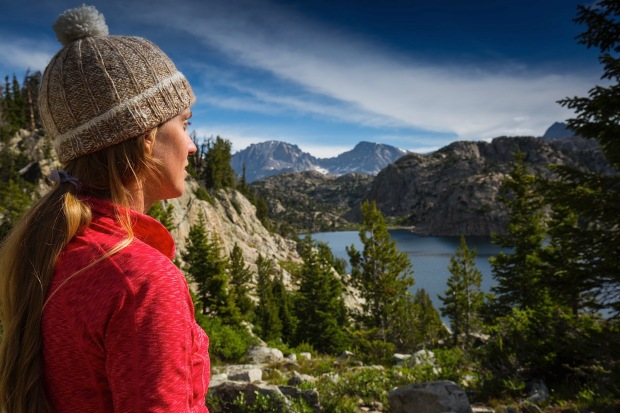 Ellen Slaton hiking to and looking out over Seneca Lake in the Wind River Range