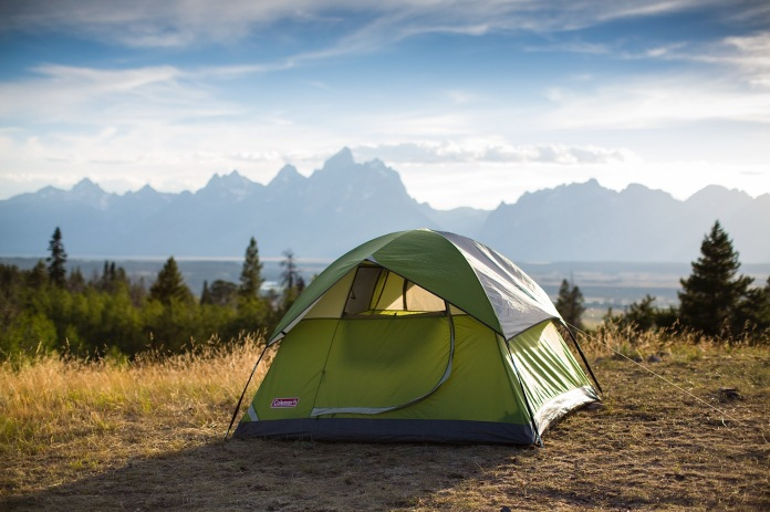 Coleman tent with Tetons in the background