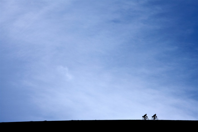silhouetted cyclists on trail ridge road, Rocky Mountain National Park, CO