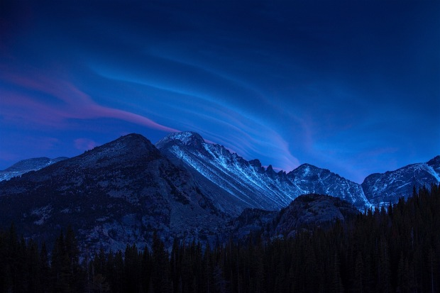 A front rolls in at dawn over Long's Peak in spectacular color.