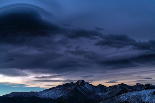 A front rolls in over Long's Peak in spectacular color.