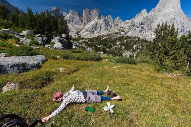 A hiker relaxes after to tough hike over Jackass Pass in the Cirque