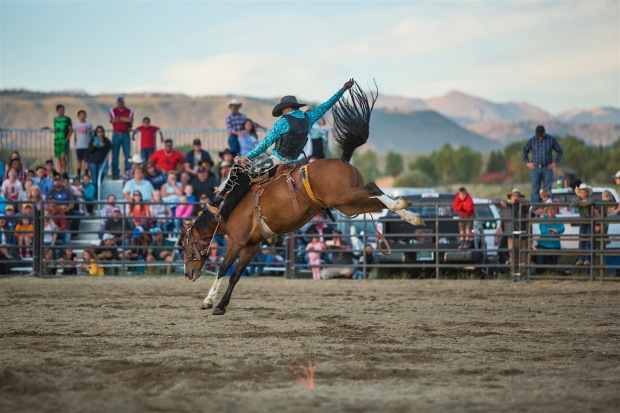 The Rendezvous Rodeo in Pinedale, Wyoming celebrates the cowboy lifestyle of the area and the fur trappers/ mountain men of the past in the Wind River Range of the Rockies