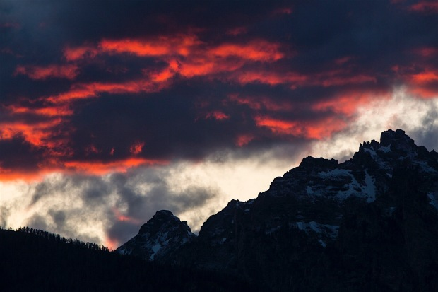 Dramatic clouds loom over Swabachwers Landing in Grand Teton National Park