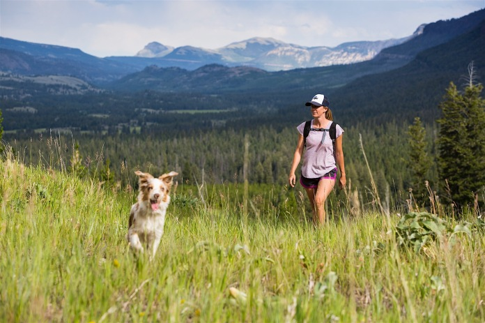 A woman and her dog hike Pilot Creek in the Absaroka Beartooths
