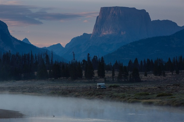 Squaretop and the Green River at dawn with a camper trailer