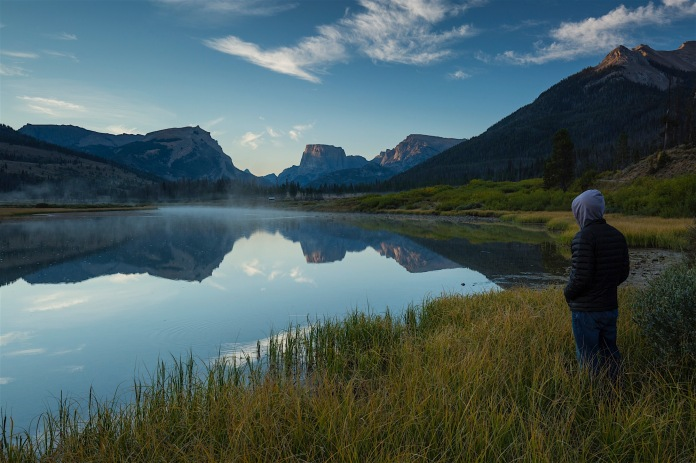A man watching sunrise in the upper Green River Valley